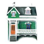 Emerald green house with wind vane and white trim.