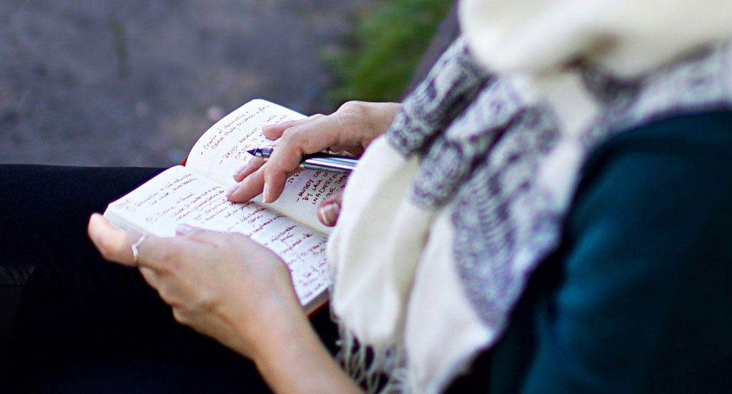 Closeup of my hands and journal